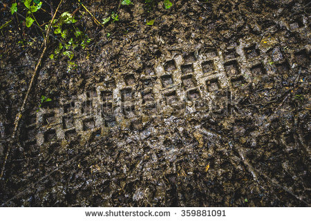 stock-photo-a-trail-in-the-dirt-from-a-motorcycle-enduro-359881091